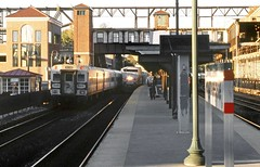 Amtrak arriving train and a Metro-North Railroad commuter train are seen in passenger station at Poughkeepsie, New York, Fall 2002