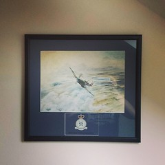 Finally got the painting of a spitfire my grandpa gave me with his squadron up on the wall, it looks great :)