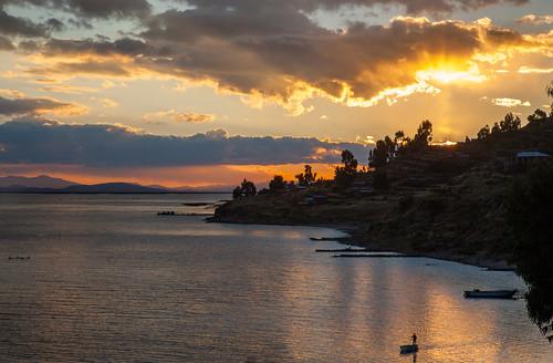 sunset peru laketiticaca boats atardecer lagotiticaca titiqaqa llachon capachicapeninsula hospedajesamaray