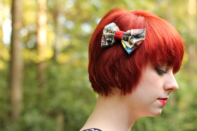Superhero Print Bow on Short Bright Red Hair