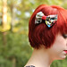 Small photo of Short Red Hair and a Superhero Print Hair Bow