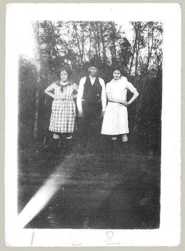 Two women and a man in a vest