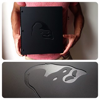Custom portfolio in matte black with enraving treatment