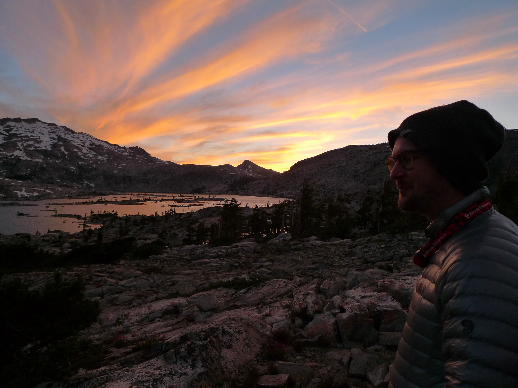 Patrick enjoys the sunset over Lake Aloha and the Crystal Range