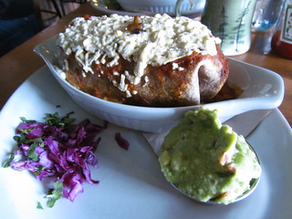 Bobcat Baked Burrito (potatoes, onion, cabbage, pinto, Daiya, sour cream, guac) at Bandidas