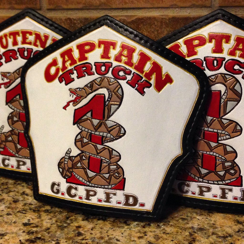 Custom fire helmet shield with red 1 and snake