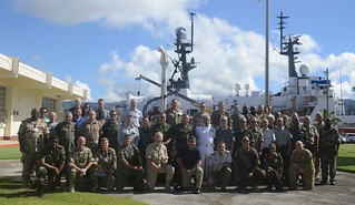 Foreign Defense Attachés are shown posing for a group photo after a tour of the 378-foot Coast Guard Cutter Morgenthau at Coast Guard Base Honolulu, Sept. 16, 2014. The Defense Attachés, representing 34 different nations visited the base as part of an Operations Orientation Program to highlight military programs of all services, introduce them to U.S. military, homeland security, defense missions, facilities, systems and capabilities and also expose them to historical and cultural aspects of American society. (U.S. Coast Guard photo by Petty Officer 2nd Class Tara Molle)