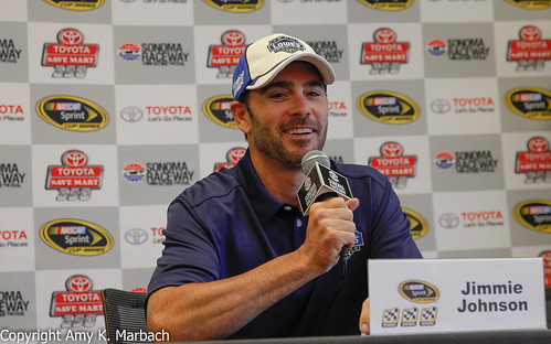Jimmie Johnson smiling in the media center