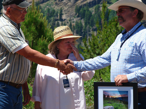 The Rocky Mountain Elk Foundation's Oregon and Washington Lands Program Manager Bill Richardson (right)  thanks representatives from the D.R. Johnson Family who sold the land to Rocky Mountain Elk Foundation for donation to the Forest Service. (U.S. Forest Service/Ken Sandusky)
