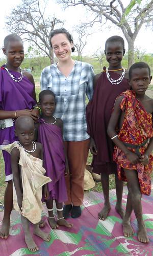 ILRI researcher Tarni Cooper with children from a livestock-keeping household in Morogoro, Tanzania