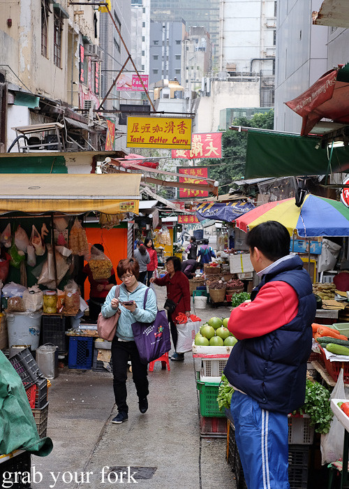 Stalls and shoppers at the Graham Street market, Central district, Hong Kong
