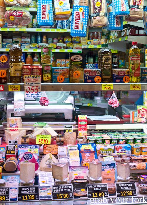 Delicatessen cheeses and groceries in Mercado de la Cebada in Madrid, Spain