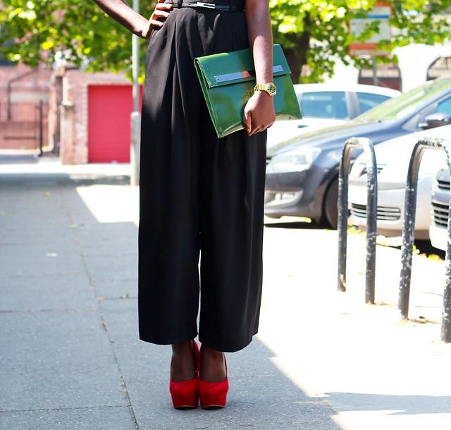 red-heels,-green-envelope-clutch-gold-watch-wide-leg-pants