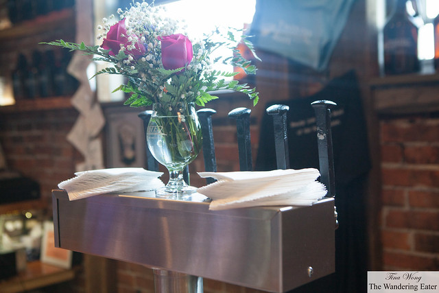 Glass of roses and railroad spikes as beer tap handles