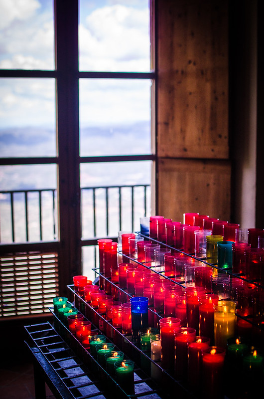 Colorful prayer candles are lit at a small chapel at Montserrat.