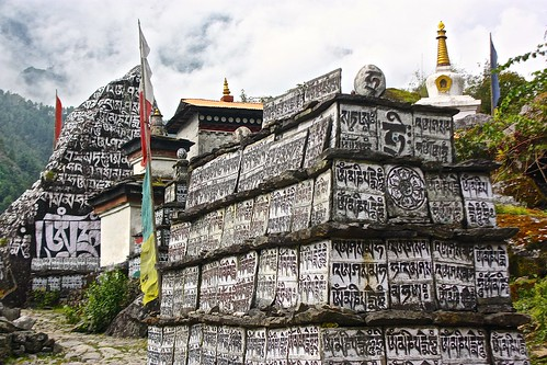 Buddhist mantras written all over these tablets next to a small Gompa