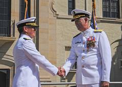 Adm. Harry B. Harris, Jr., left, commander of U.S. Pacific Fleet, congratulates Rear Adm. Russell S. Penniman during Penniman's retirement ceremony at Naval Air Station North Island. (U.S. Navy/MC2 Jason Baird)