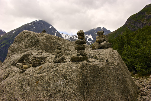 Rock sculpture in front of the Briksdalsbreen (aka Briksdal glacier)
