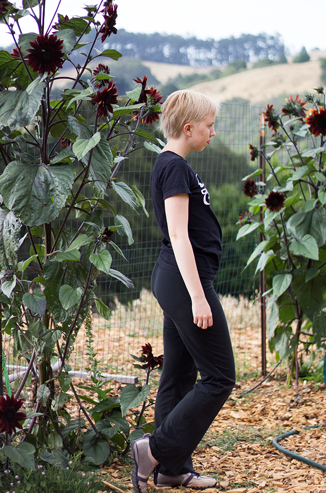 all-black outfit, tall black sunflowers