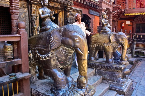 a man and his elephants at the Golden Temple in Patan