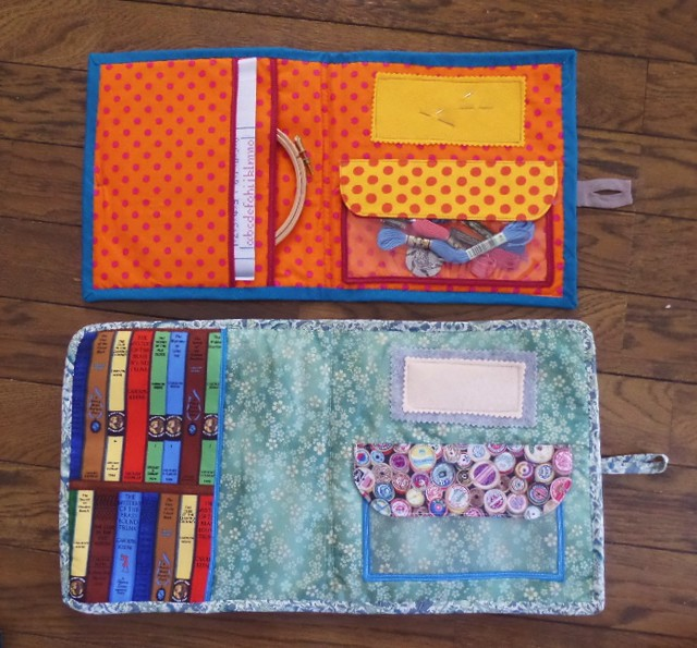 Insides of two embroidery cases