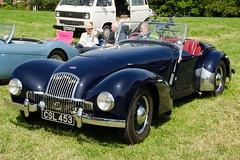 race car, automobile, jaguar xk120, vehicle, automotive design, antique car, classic car, vintage car, land vehicle, luxury vehicle, sports car,