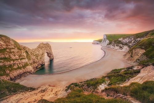 uk longexposure greatbritain sunset sea summer england sun beach stone canon coast seaside arch unitedkingdom calm dorset curve f28 6d durdledoor lseries 1635mm aoanb richjjonesphotography richjjones