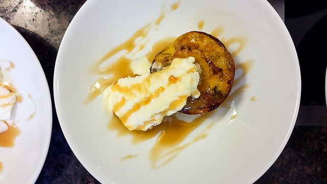 grilled niagara peach with vanilla ice cream and crown royal caramel sauce