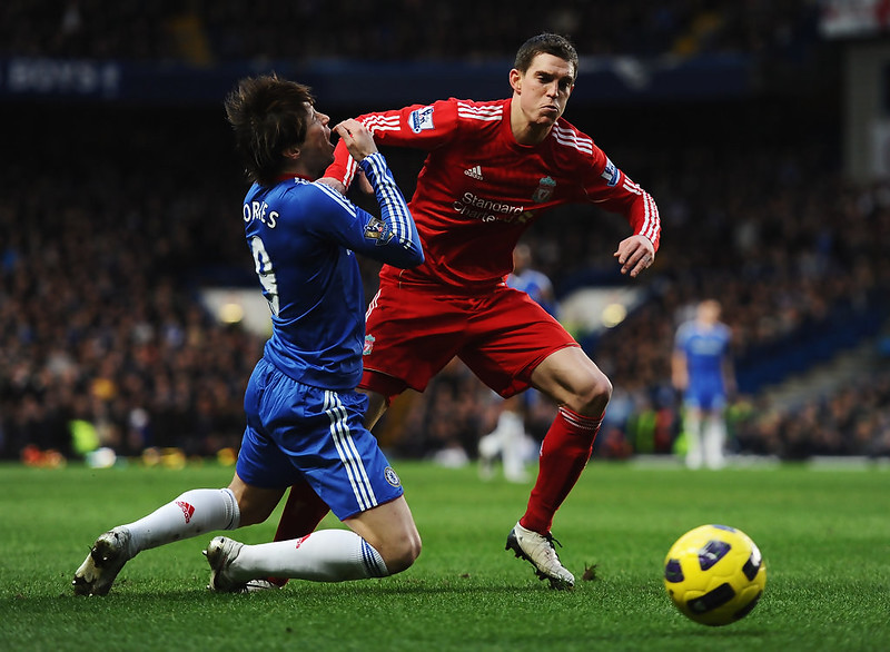 Daniel Agger shows Fernando Torres his elbow
