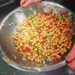 Tossing together a chickpea basil salad!