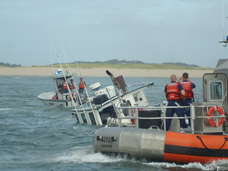 Coast Guard Station Chatham rescued a fisherman after being caught in the surf on the Chatham Bar in Chatham, Mass., Wednesday.