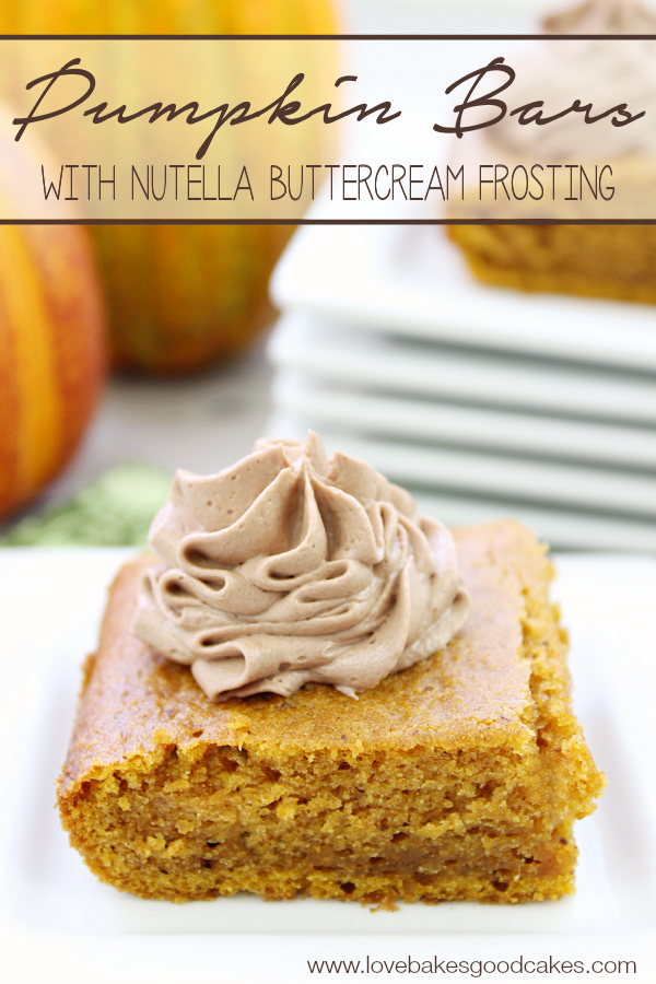 Pumpkin Bars with Nutella Buttercream Frosting on a white plate.