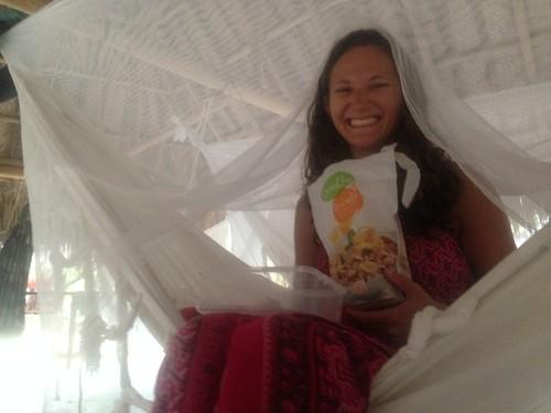 Lina eating breakfast in her luxury hammock in Tayrona