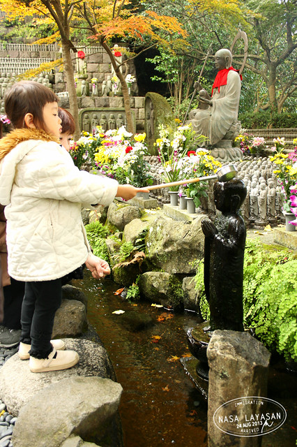 Child paying respects at Hasedera