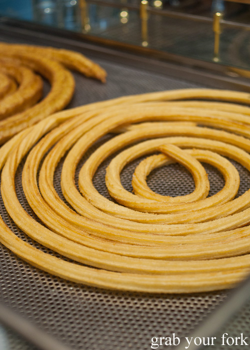 Giant coils of churros at Chocolateria San Gines in Madrid, Spain