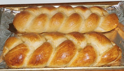 Two loaves of braided glazed white bread