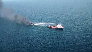 An offshore supply vessel assists in the rescue of five people after their 40-foot vessel caught fire near Petit Bois Island, July 25, 2014. Two good Samaritan vessels arrived on scene and aided in fighting the fire and transferring the five passengers to the Coast Guard 45-foot response boat, which safely transported the passengers to Station Dauphin Island. (U.S. Coast Guard photo courtesy of Coast Guard Air Station New Orleans)