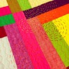 """may have figured out a solution to cover/disguise the issues on the """"turd"""" quilt:  running stitch spirals using perle cotton.  still deciding whether to sprinkle it around the quilt or hand quilt the whole quilt with the spirals..."""