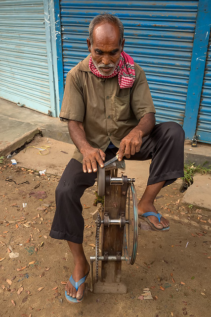 A knife sharpener in the streets of Dhaka, Bangladesh.