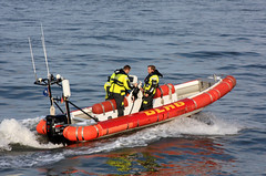 dinghy(0.0), skiff(0.0), sea kayak(0.0), rescue(0.0), vehicle(1.0), sea(1.0), boating(1.0), motorboat(1.0), inflatable boat(1.0), rigid-hulled inflatable boat(1.0), watercraft(1.0), boat(1.0), coast guard(1.0),