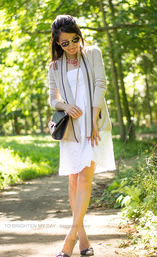 orange necklace, camel open sweater, white eyelet dress