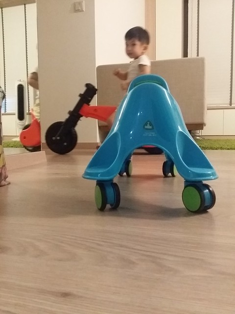 The kids zooming around the house in their 'bikes'.