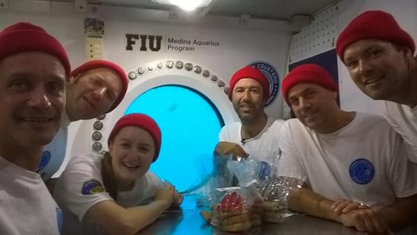 group shot of aquanauts inside Aquarius