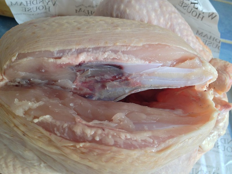 How to Butcher a Chicken : Slice down the back bone