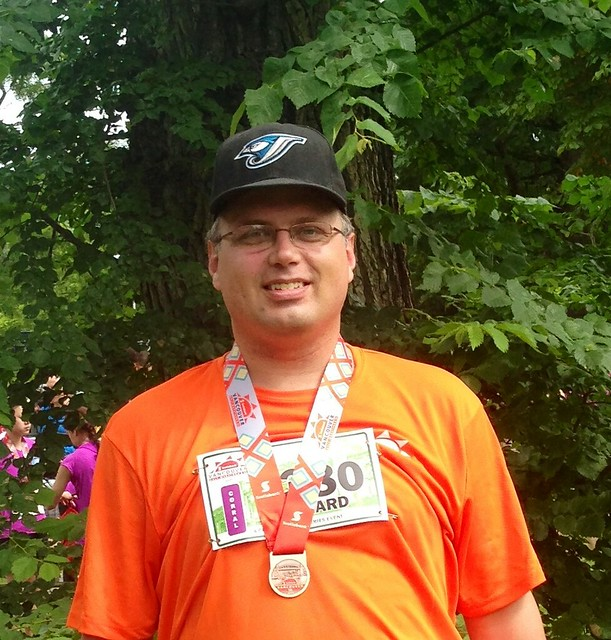 Me and my medal after running the Scotiabank 5k