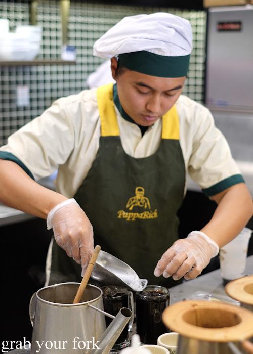Making Malaysian iced coffee at Pappa Rich, Broadway