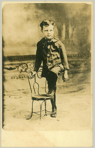 RPPC Boy and chair