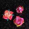 "Making #origami "" #Kawasaki "" #roses... My first time for the one on the right, and the paper tore a little at the edge..."