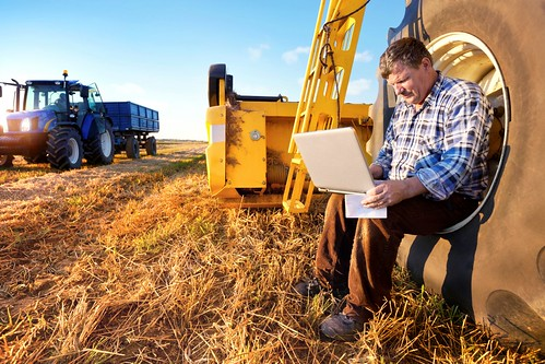 Farmer using computer in the field