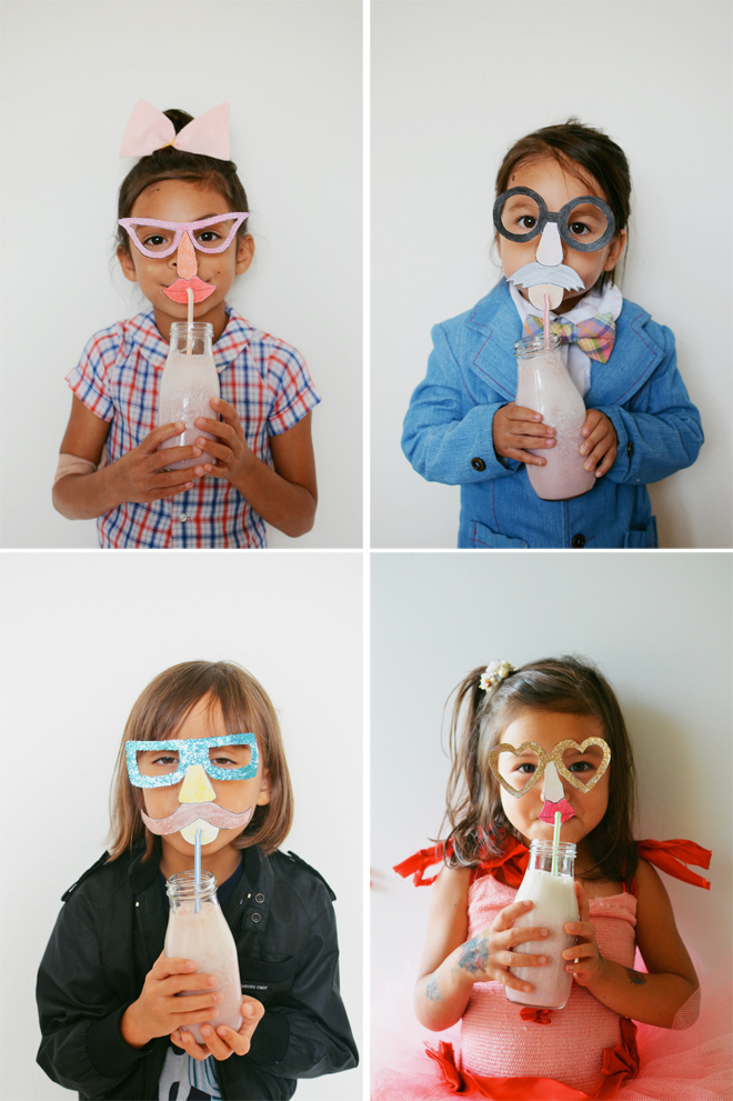 strawberry milkshakes with funny face straw toppers